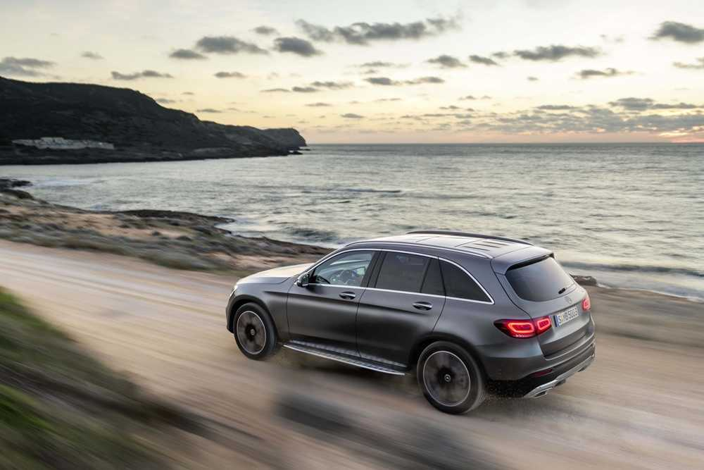 The new Mercedes-Benz GLC from behind, travelling along a coastal route