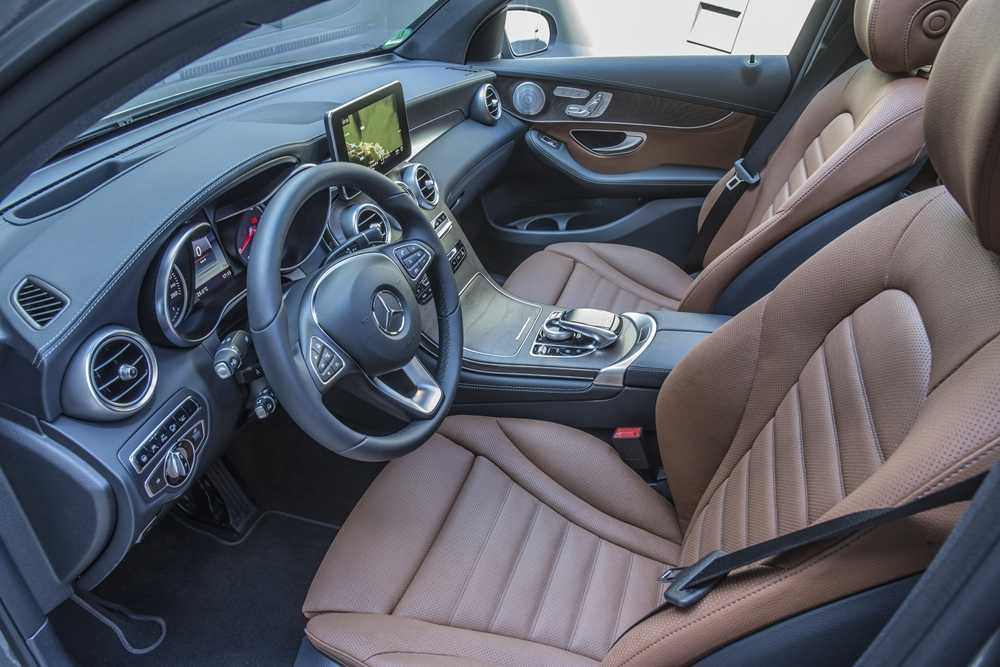 The interior is typically Merc, with a mix of leather and metallic detailing
