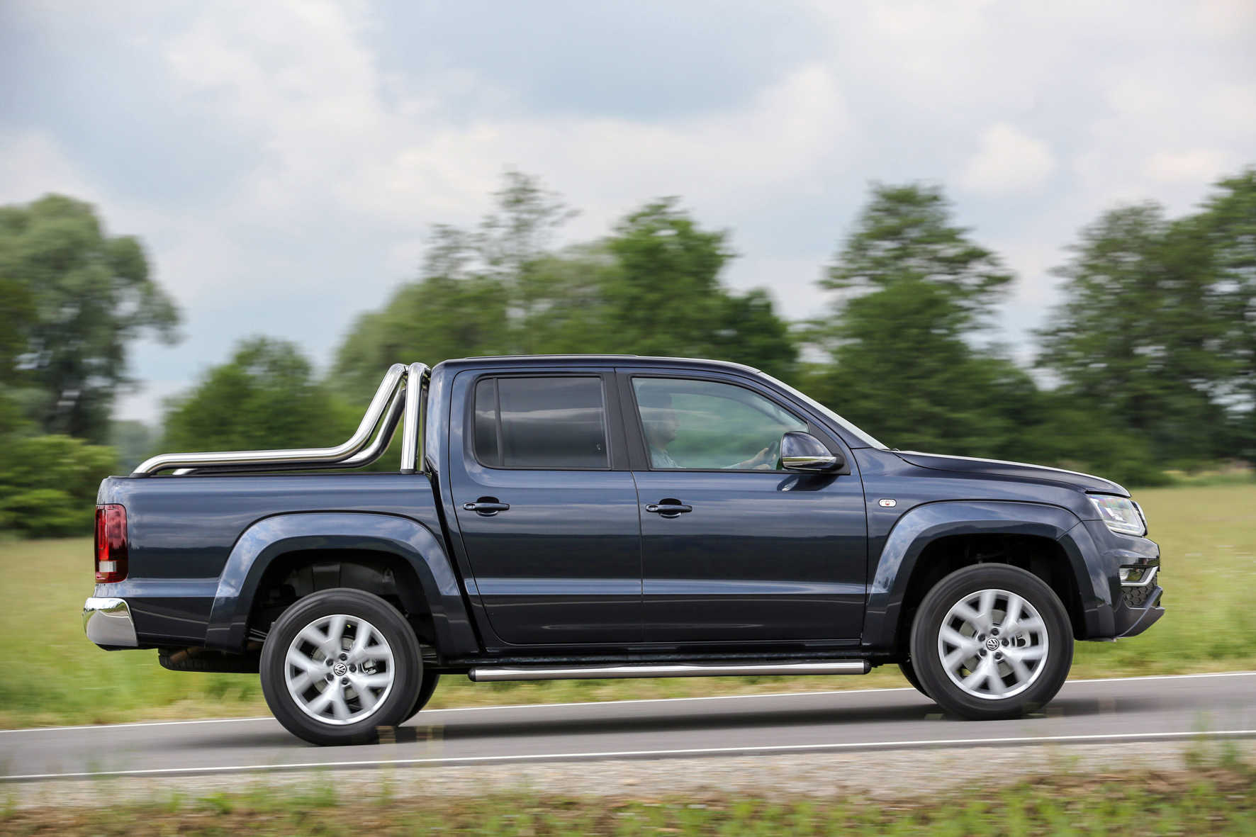 The Amarok V6 travelling along a tree-lined road