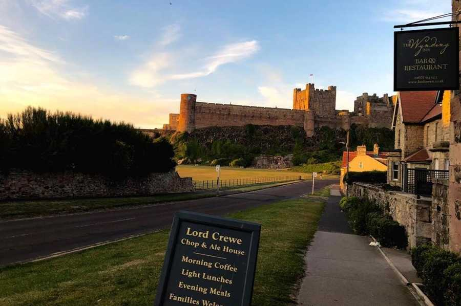 Outside the Lord Crewe in Bamburgh at sunset